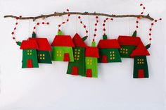 Group of eight Felt Houses for decoration for hanging. Wall Art. Red and Green colors. Christmas ornaments. Felt House decoration for all seasons. Decoration for wall hanging as well. Holiday gift for everyone too. Small wooden twig not included. House measures aproximate: 3.5 - 5 x 4 - 6.5 Hanging measures aproximate.: : 4 - 10 The entire collection of miniature houses can be seen in the section: http://www.etsy.com/shop/Intres?section_id=6346878
