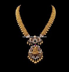 Exotic designer piece with tiny gold bits clustered tightly and edged with gold tussi balls, this lavish designer gundla mala or ...