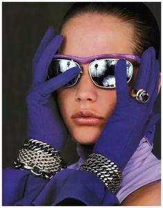Blue gloves with silver bracelets