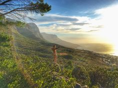 """Nakedness  12 Apostles Mountain Range and the Atlantic Ocean during a beautiful sunset here in Cape Town South Africa.  I started my naked travel photos around the World journey 4 years ago and it's still going strong .  A perfect ending to my last day here. """"Remind yourself that you don't have to do what everyone else is doing."""" by jeremiahworldwide http://ift.tt/1ijk11S"""