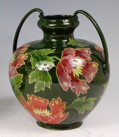 16 - An Austrian Art Nouveau glazed ceramic twin handled vase by Julius Dresler