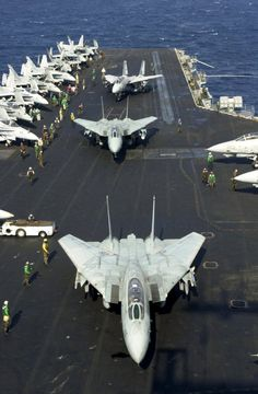Nov. 9, 2001 — F-14 Tomcats prepare to take off from the flight deck of USS Enterprise.