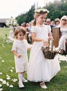 Cute + classic flower girl and ring bearer: http://www.stylemepretty.com/2015/11/06/rustic-elegance-at-camp-yonahnoka/ | Photography: Clark Brewer - http://www.clarkbrewerphotography.com/