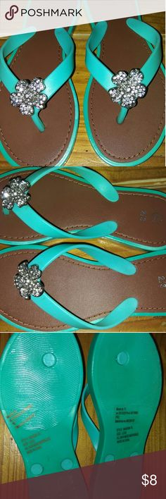 Adorable jewelled kids flip-flops Green girls flip-flops with jewelled flowers at toes. Tried on. Never worn outside. other Shoes Sandals & Flip Flops