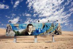 A roadside mural of Bashar al-Assad along the Damascus to Aleppo highway.