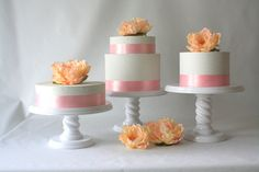Simple wedding cakes on multiple stands    Wedding Cake Stand Trio - set of three wedding cake stands in white, round wood cake stands. $75.00, via Etsy.