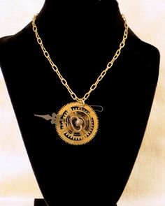 Steampunk Clock Gear Necklace by CodachromeCreations on Etsy  Handmade item Cost:$45 usd Length: 20 - 28 inck inches Materials: Vintage clock parts, Jump rings Ships worldwide from Thousand Oaks, California