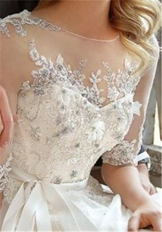 White lace and jewelry-embroidered bodice, wedding dress