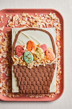 We've never seen a more adorable Easter cake recipe than this one! The piped frosting to look like a woven basket makes a stunning decoration. Add the egg sugar cookies for the ultimate cake decoration, or use a purchased cookie or candy to pull it together faster. #easterfood #easterideas #eastercake #cutecakeideas #bhg Spring Recipes, Easter Recipes, Cookies Light, Desserts Ostern, Cake Recipes From Scratch, Homemade Cake Recipes, Cake Flavors, Toasted Coconut, Cakes For Boys