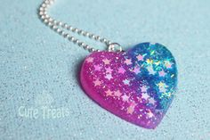 Resin Heart Necklace - Half yours, half mine This beautiful creation is half pink and half blue with tiny stars and glitter! A unique creation! Resin Heart Necklace - Half yours, half mine :) Kawaii Jewelry, Cute Jewelry, Jewelry Accessories, Fashion Accessories, Unique Jewelry, Resin Necklace, Cute Necklace, Necklaces, Unicorn Fashion
