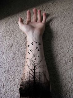 shadows of birds in flight tattoos | Tree with black birds tattoo on the Arm