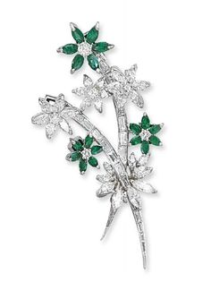 AN EMERALD AND DIAMOND BROOCH, BY BULGARI   Designed as a floral spray, the emerald and diamond flowerheads set en tremblant, 6.0 cm, in white leather Bulgari case  Signed Bulgari