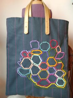 Bolso bordado geometrico.lucia vega 2013