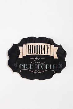 "$34    * Wall sculpture crafted from wood grain plywood and topped with a text-graphic  * A quirky design piece that will complement any space  * Pre-attached fixtures for easy hanging  * 12""l, 9""h"