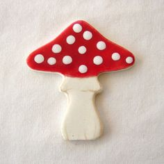 Mushroom. exactly like this. In fact, I may have to go buy this from etsy (only $3) because this is too adorable.