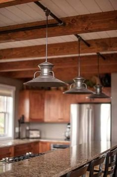 Industrial Style Pendant Lights in a Yankee Barn Running electrical through industrial pipe painted black