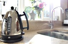 Morning habits - sink and kettle with sun shining
