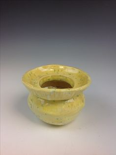 My vase which I found yellow and speckled green color for.