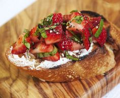 Strawberry Bruchetta with grilled baguette, goat cheese, strawberries, basil and black pepper drizzled with balsamic
