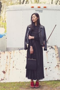 Dress and bag at Good & Maggie; Leather jacket, Liu's own at Balenciaga