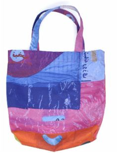 """Large Deeper Rainbow Bag  Artist:   Citizen Love  Dimensions:   18"""" x 14""""  Medium:   Printed on 80% recycled cotton / 20% recycled bottle fabric    About:   This very colorful tote is about 18"""" high by 14"""" wide (45x35cm) with good comfy handles. They're made from recycled cotton (the waste scraps that normally go straight to landfill) and PET (which is made from plastic bottles)."""