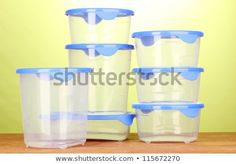 Plastic containers for food on wooden table on green background Plastic Food Containers, Food Storage Boxes, Green Backgrounds, Wooden Tables, Photo Editing, Royalty Free Stock Photos, Wood Tables, Editing Photos, Photo Manipulation