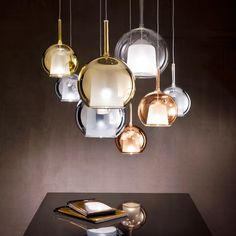 Design by Carlo Colombo  Lamps with structure in chromed metal and borosilicate glass. Outer shade transparent, iridescent gold and silver. Internal diffuser sandblasted. A request for chrome ceiling rose triptych.