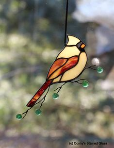 A stunning Female Cardinal stained glass suncatcher for your home. This beautifully handcrafted suncatcher measures approximately 9 X 5.25. I like to combined my two passions, stained glass and wildlife photography. I am very particular about the glass choices I use in my bird