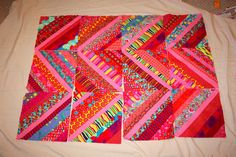 I have very few unfinished projects stashed away, but these string squares are one of them.  I made these very early on in my quilting and...