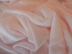 Pale pink sheer polyester chiffon fabric, by the yard
