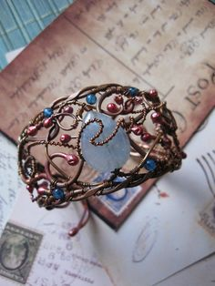 Hey, I found this really awesome Etsy listing at http://www.etsy.com/listing/154737846/wire-wrapped-bracelet-wire-cuff-bracelet