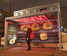 "As part of a campaign for their new ""Hot 'n Wholesome"" breakfast menu, Caribou Coffee's ad agency, Colle + McVoy, created these amazing bus shelter advertisements for the city of Minneapolis. Not only do they look like giant ovens, but the heating element on the roof actually works! So those waiting inside stay as toasty as the breakfast sandwiches appearing on the poster behind them."