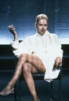 """BASIC INSTINCT"" (1992) - In Sharon Stone's bad-girl breakout, she oozes kinky danger as ice-pick-wielding bisexual novelist and man-eater."