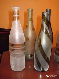 For my bottle tree: Take the label off of wine bottles, put painters tape in different designs, spray with spray paint, let dry, and peel off the tape. This would be a good idea for a centerpiece idea! A few at each table with different designs Wine Bottle Corks, Diy Bottle, Wine Bottle Crafts, Jar Crafts, Painted Wine Bottles, Bottles And Jars, Glass Bottles, Decorated Wine Bottles, Empty Liquor Bottles