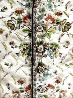 Detail front view, waistcoat, France, 1775-1785. Cream silk satin, embroidered with floral sprays and floral motifs.