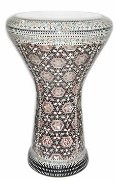 """17"""" Mother of Pearl Doumbek Drum Gawharet El Fan Darbuka by Gawharet El Fan. $249.00. This is a beautiful new 17"""" darbuka. Comes with a clear synthetic head and a premium case. This drum is a top quality drum with shiny shells Egyptian decorations. The Beautiful and intricate inlay of real mother of pearl and the beautiful shiny patterns, make this drum a real work of art. Covered with real mother of pearl that reflects the spectral colors with shiny shells patterns. ..."""