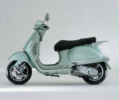 Vespa Granturismo 200L and 125L, 2003 – In 2003, the Granturismo made its appearance as the most powerful Vespa ever produced. In 200L and 125L versions, it combines the Vespa's emotional appeal with state-of-the-art technology: this was the first-ever Vespa to have sparkling four-stroke, four-valve, liquid-cooled engines that meet the new Euro 2 emissions standards, as well as 12-inch wheels and a two-disk brake system. The steel body is a uniquely Vespa touch.