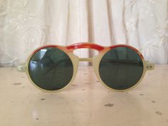 1930s / 1940s Sunglasses - Red and Cream Celluloid - Round Frames. $50.00, via Etsy.