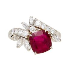 A ruby and diamond ring, Raymond Yard set with a cushion-cut ruby, accentuated by a round brilliant and marquise-cut diamond spray; signed Yard for Raymond Yard; ruby weighing approximately: 3.00 carats; mounted in platinum.