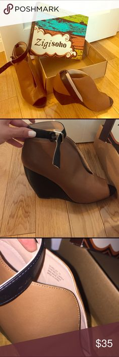 NIB wedges! Synthetic upper. Tan and black open toe wedge. New in box and never worn. Zigi Soho Shoes Wedges
