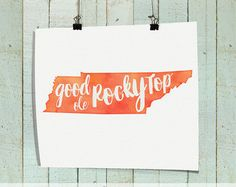 For people who want to show their Tennessee pride: Good Ole Rocky Top This watercolor canvas sign is the perfect addition to any Tennessee Volunteer fans home. Show off your team spirit proudly and in style. This canvas looks beautiful hung in your office, living room, dorm room, or bedroom. Such a great gift idea for graduations, Christmas, birthdays, and Fathers Day! This canvas is stretched around a wood frame and is ready to hang -- no frame necessary. Please note, the image is not…
