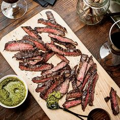"Grilled Skirt Steak with Green Sriracha | ""So many cultures have some version of a pesto or chimichurri,"" says Susan Feniger, who uses southeast Asian coconut, chiles and kaffir lime leaves to create a green Sriracha, a Thai-style hot sauce."