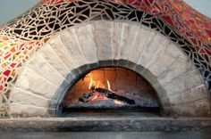 Mediterranean Italian mosaic brick oven wood-fired pizza oven forms the centerpiece of West First Pizza - Google Search