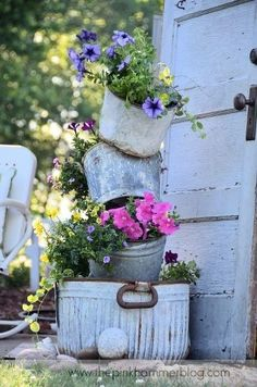 Cottage style outdoor garden, flowers in metal tin buckets; Upcycle, Recycle, Salvage, diy, thrift, flea, repurpose! For vintage ideas and goods shop at Estate ReSale & ReDesign, Bonita Springs, FL