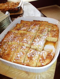 Oven french toast: Mix 1/2c melted butter & 1c brown sugar. Pour into bottom of 9 x 13 pan. Beat 4 eggs, 1 1/2c milk & 1tsp vanilla. Lay single layer of toast. Spoon half egg mixture on bread layer, add 2nd layer of bread. Spoon on remaining egg mixture. Cover & chill in fridge overnight. Bake at 350 for 45 minutes' (covered for the first 30 minutes) Sprinkle with powdered sugar. X