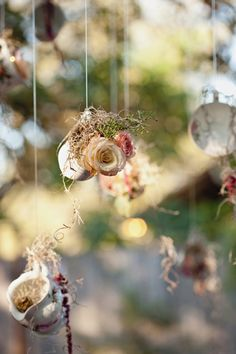 Hanging teacups with roses.