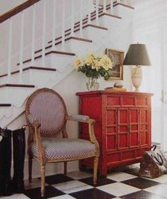"""Furniture placement at the bottom of the stairs...for """"foyer"""" in basement"""