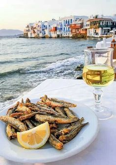 Mykonos... freshly fried fish, a fresh salad and a glass of retsina by the sea