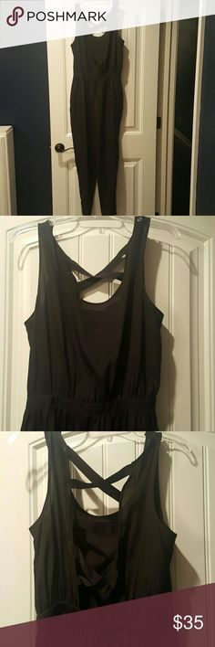BCBGeneration black Jumpsuit open-back BCBGeneration black jumpsuit with open back and tapered leg. Light material. Worn twice. Great condition. Smoke free environment. Size M. BCBGeneration Pants Jumpsuits & Rompers