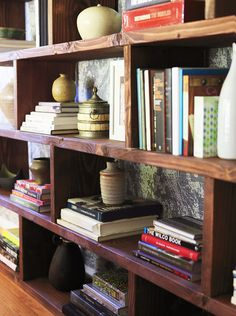 how to style a bookshelf .... I love the color and thickness of the wood ... kind of rustic
